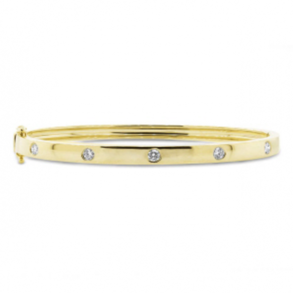 14k yellow gold polished hinged bangle bracelet with five round diamonds. Total weight: .38c