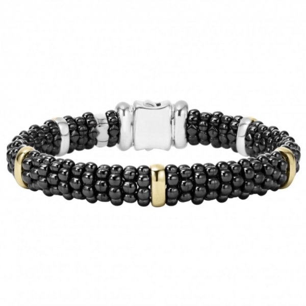 A black ceramic Caviar bracelet with five 18k gold stations. Finished with a sterling silver box clasp.