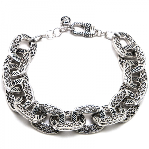 Sterling silver filigree and rope finished chunky link bracelet with a claw clasp.